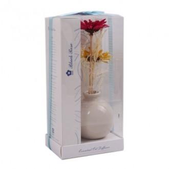 Ծաղիկ և օծանելիք ծաղկամանով